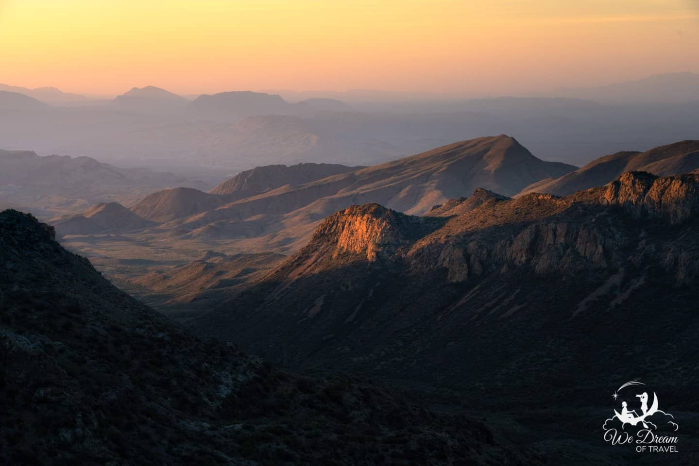 First light shines on the Chisos Basin in this sunrise picture from Big Bend National Park.