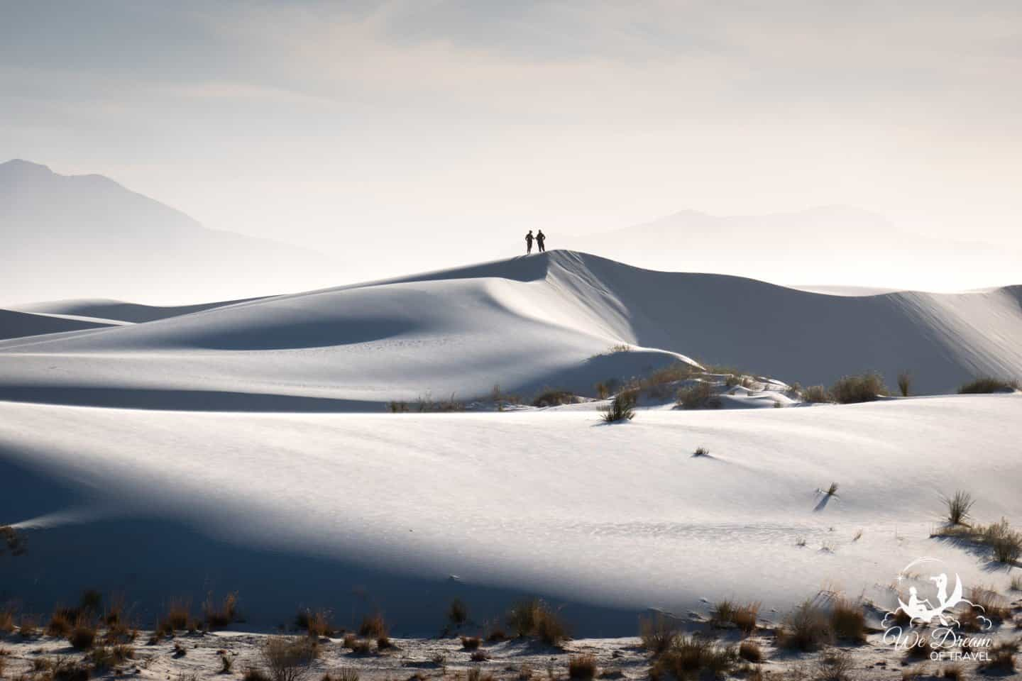 Alkali Flats photography featuring two people standing atop the sand dunes.