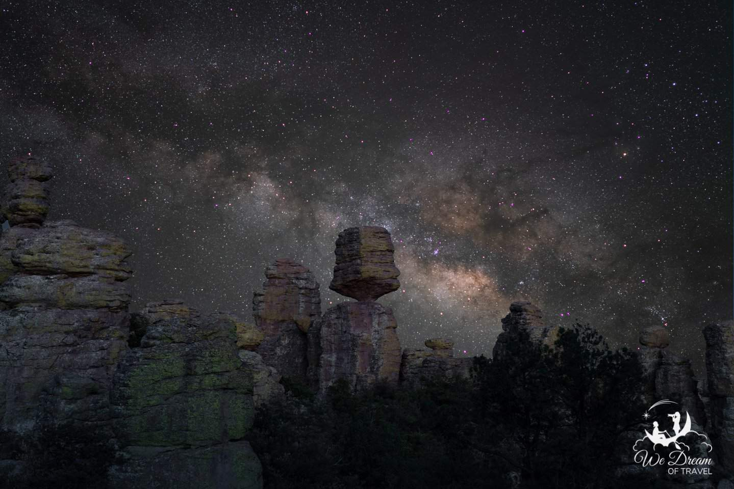Big Balanced Rock teeters in the foreground with Milky Way rising behind.