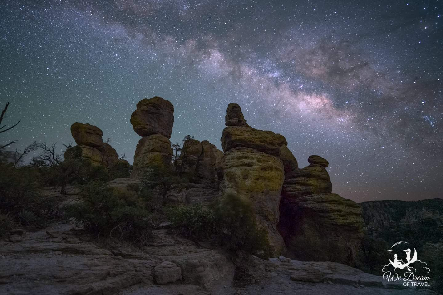 The milky way over rock formations at Chiricahua National Monument, an International Dark Sky Park.