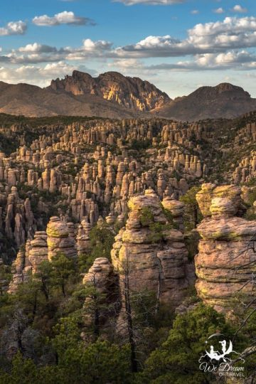 Golden hour casts light and shadows over the rock formations at Chiricahua
