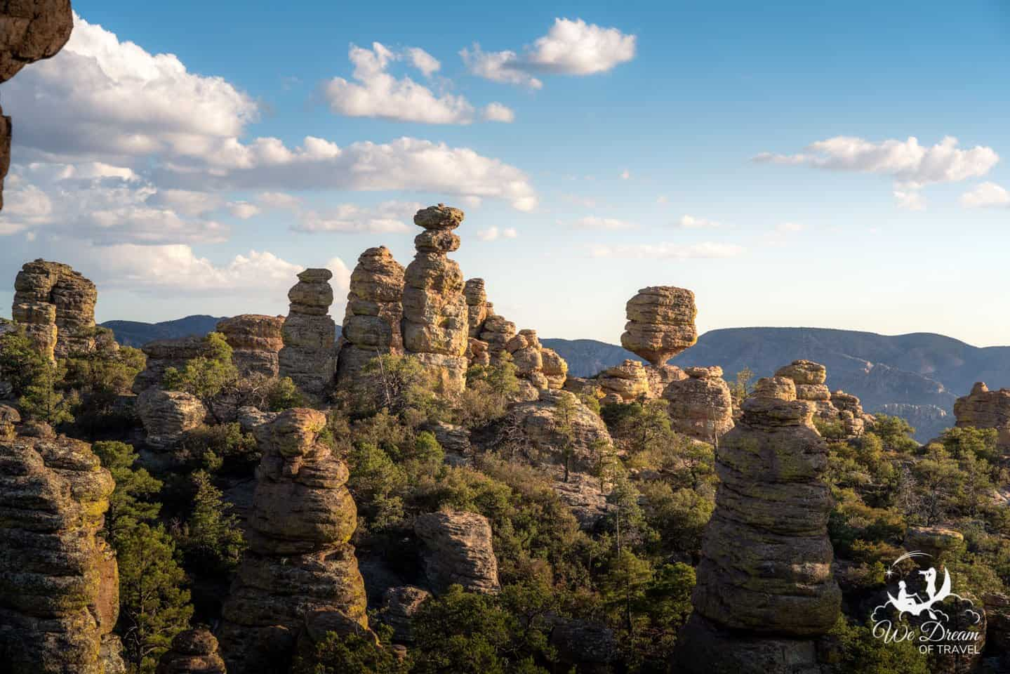 Rock pinnacles and balanced rocks against a backdrop of mountains in Chiricahua