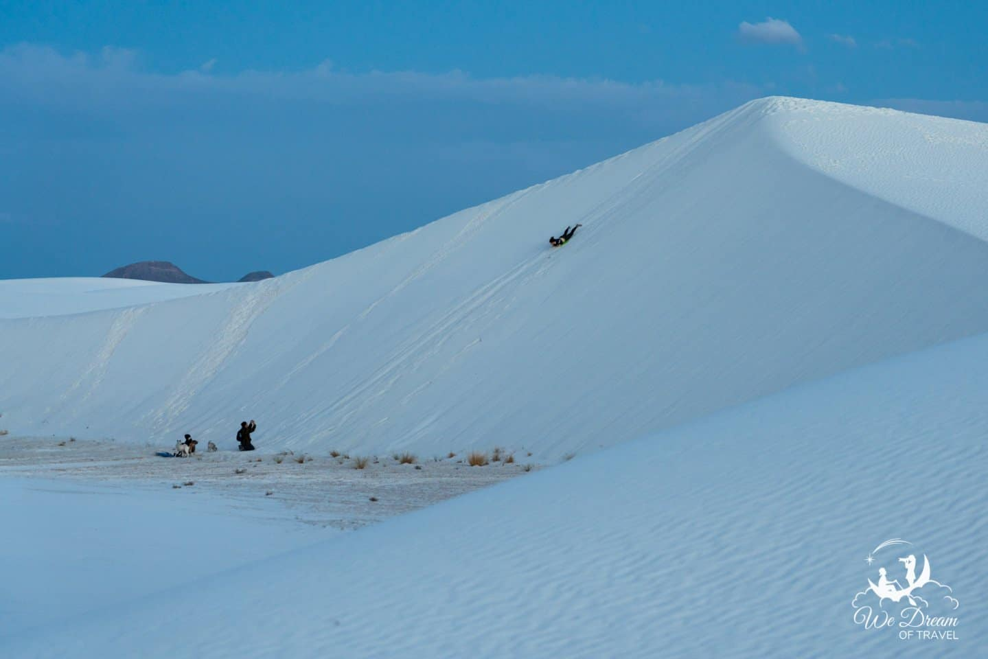 Sand sledding down a beautiful dune in White Sands NP.