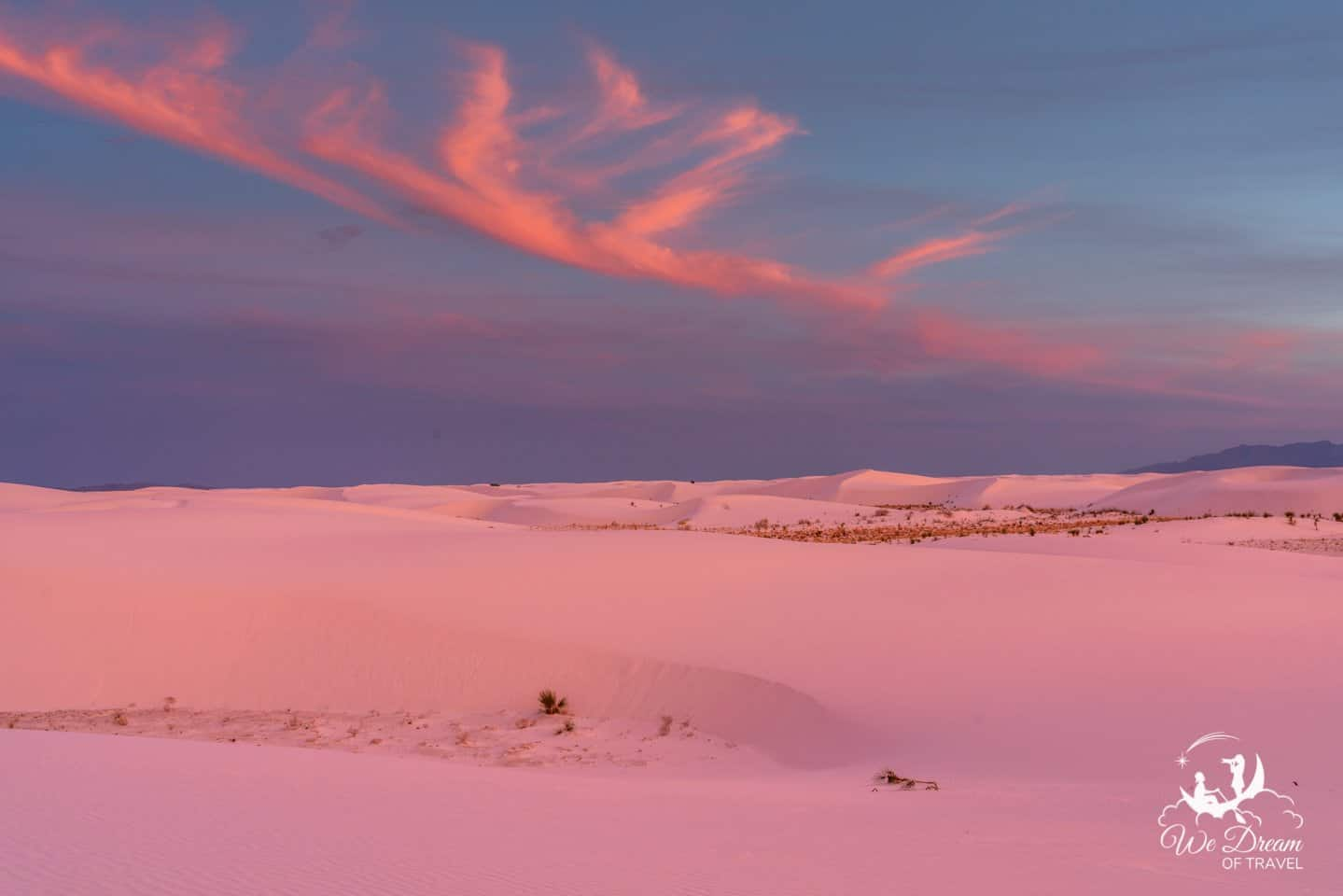 The dunes of White Sands NP glow vibrant pink during a crazy sunset.