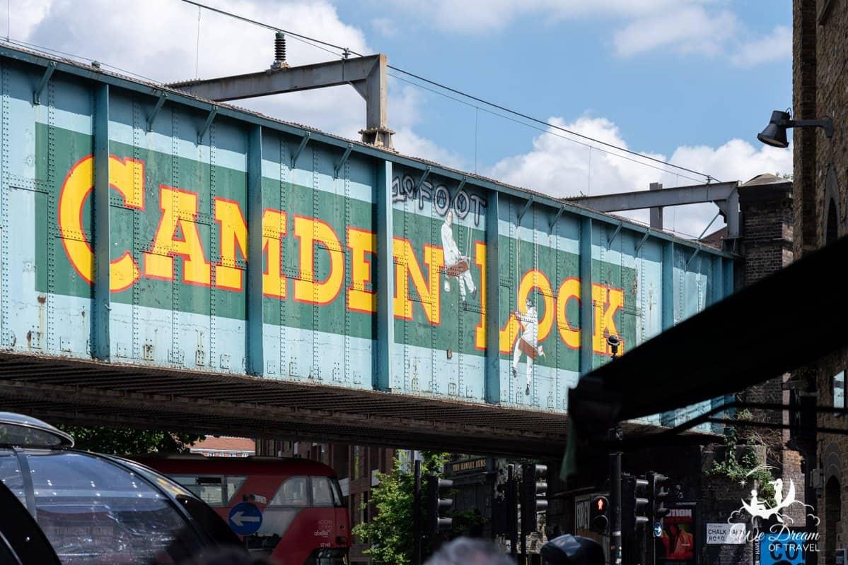 Camden Lock painted on the side of the railway bridge