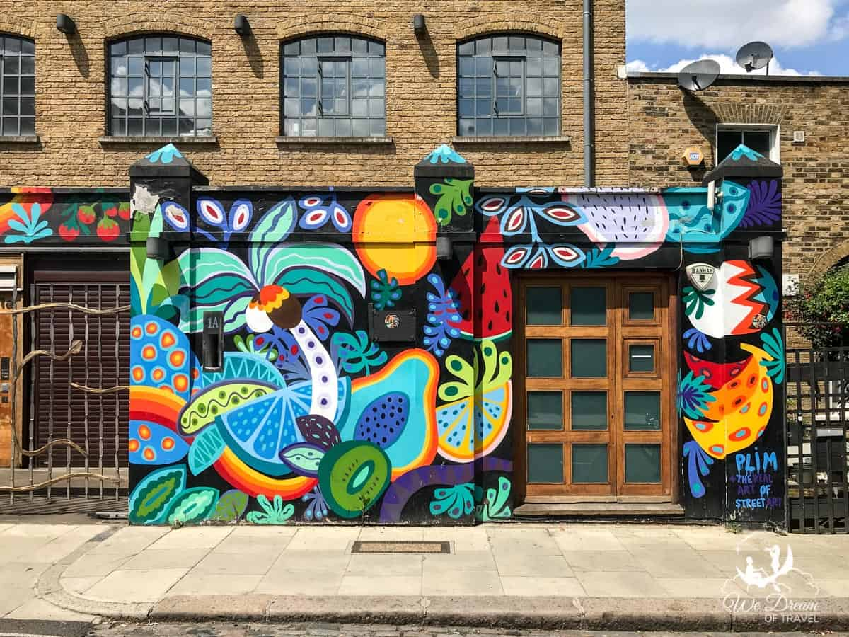 Colourful street art mural in Camden on Harmood Street