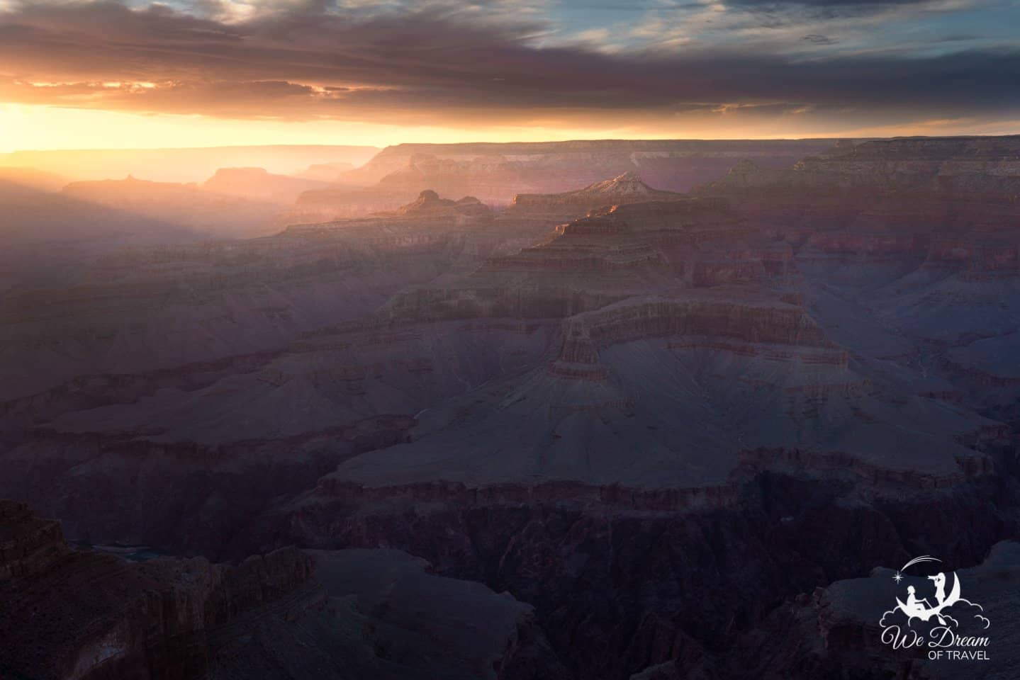 Golden light spills into the Grand Canyon at sunset from Hopi Point.