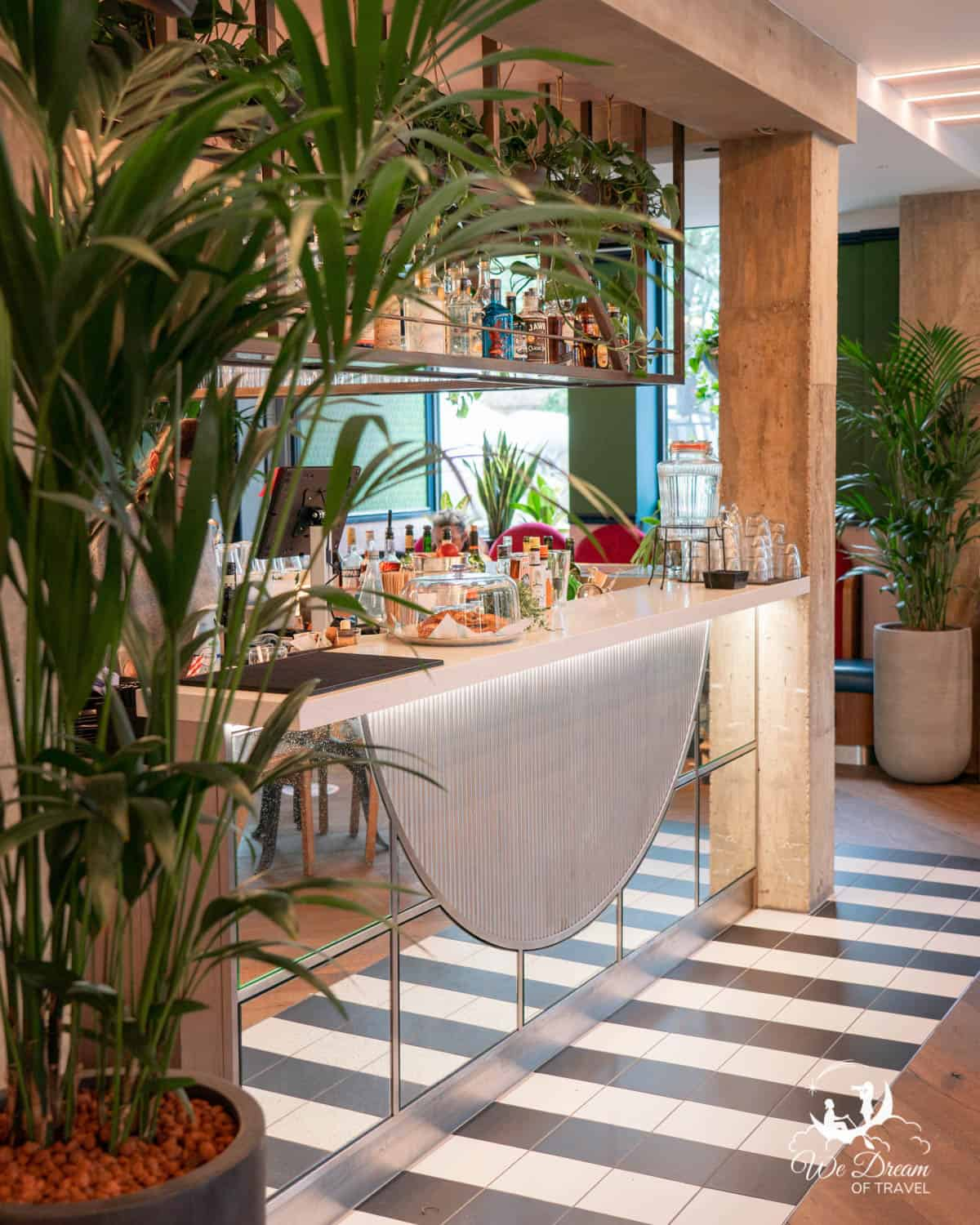 The bar surrounded by plants at Powerplant restaurant in Camden