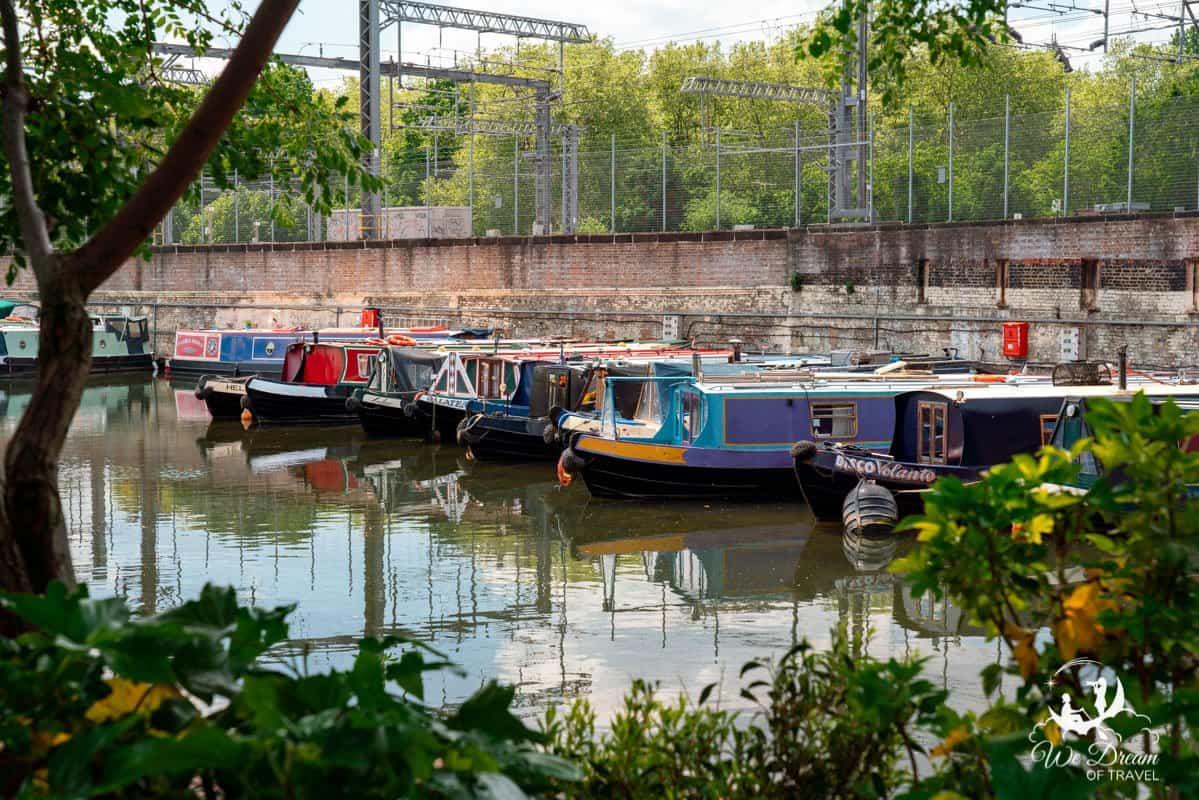 Colourful narrowboats are docked at St. Pancras Lock.
