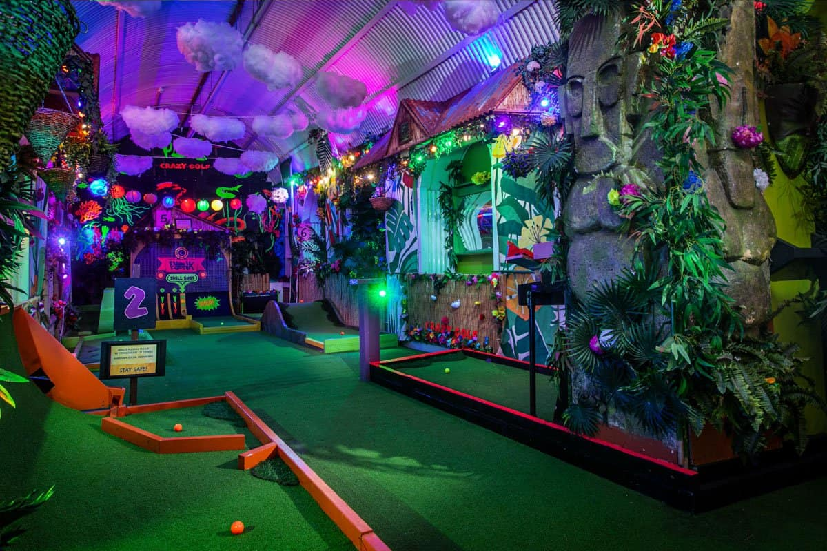 The inside of the tropical themed Plonk crazy golf in Camden