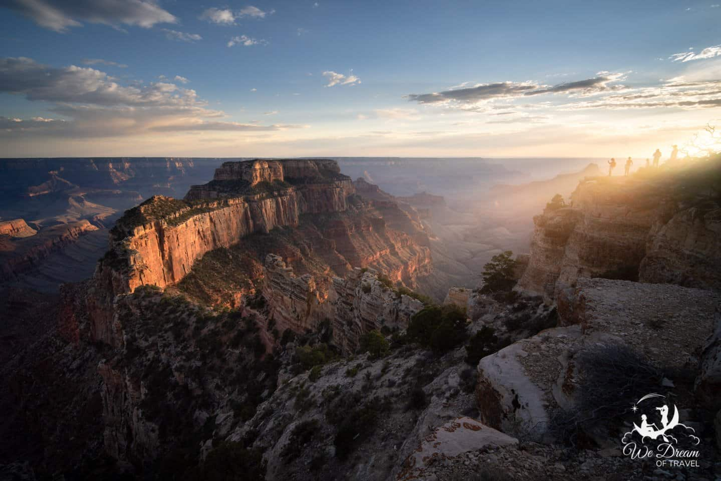 Grand Canyon visitors line the cliffs to watch sunset from Cape Royal.