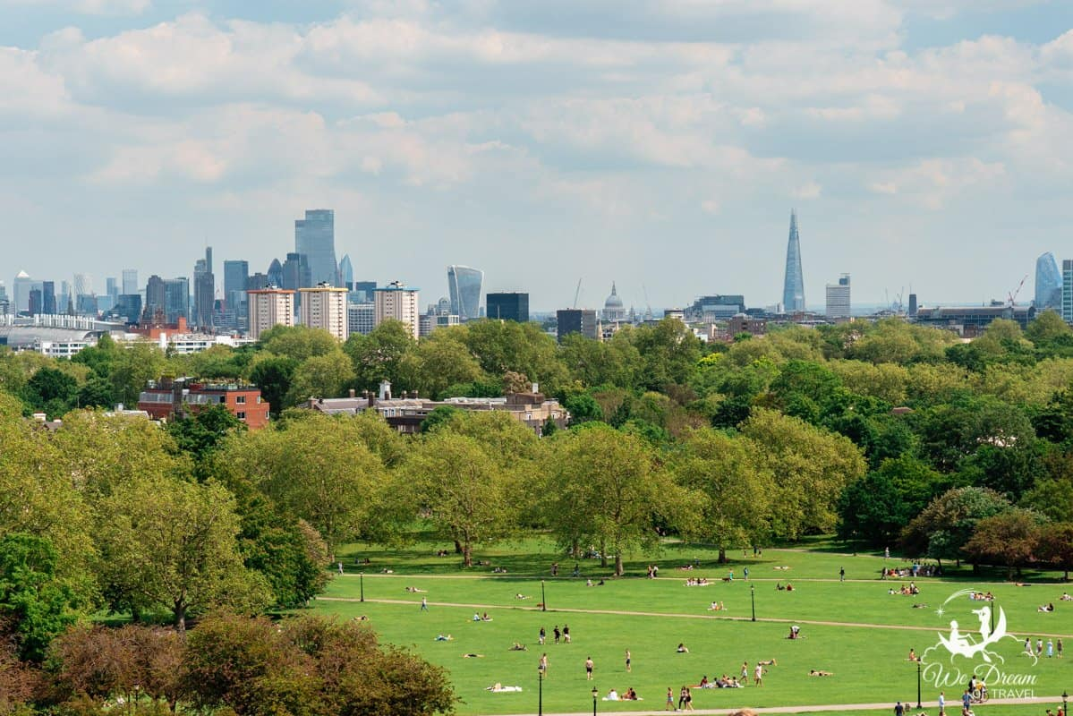 Protected view of the London skyline featuring Canary Wharf, St Pauls, The Shard and other iconic London buildings from Primrose Hill.