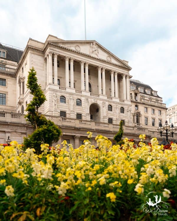 The Bank of England on Threadneedle Street London with spring flowers in the foreground.