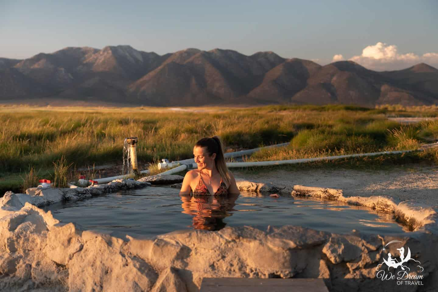 A woman enjoying golden hour at Hilltop Hot Springs (Pulkey's Pool) in Mammoth