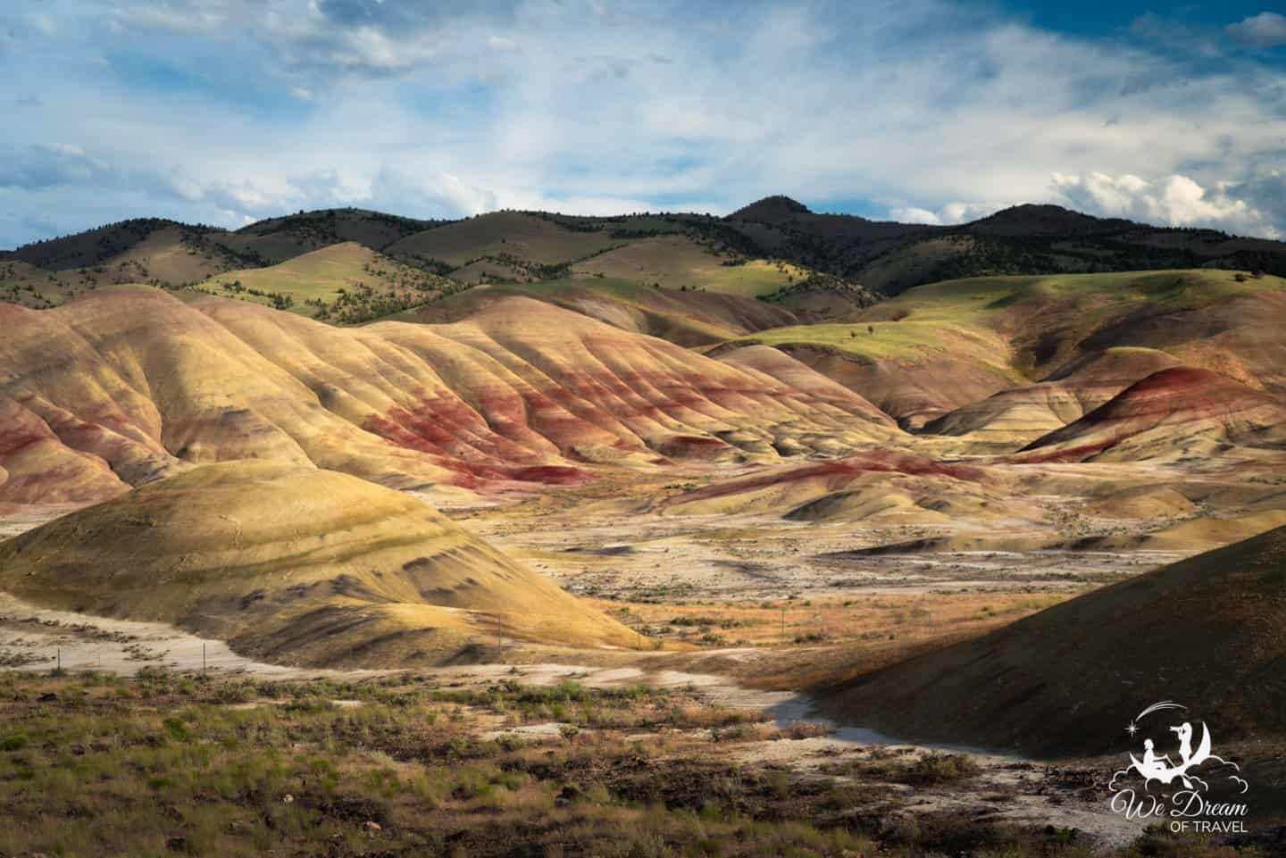 Light and shadow play accentuates the colors of the Oregon Painted Hills.