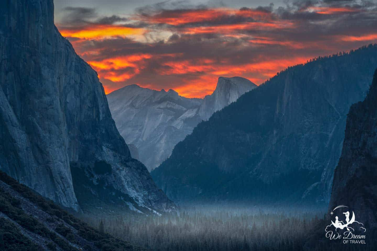 Low clouds burn fiery red on the horizon during sunrise on Day 1 in Yosemite National Park.