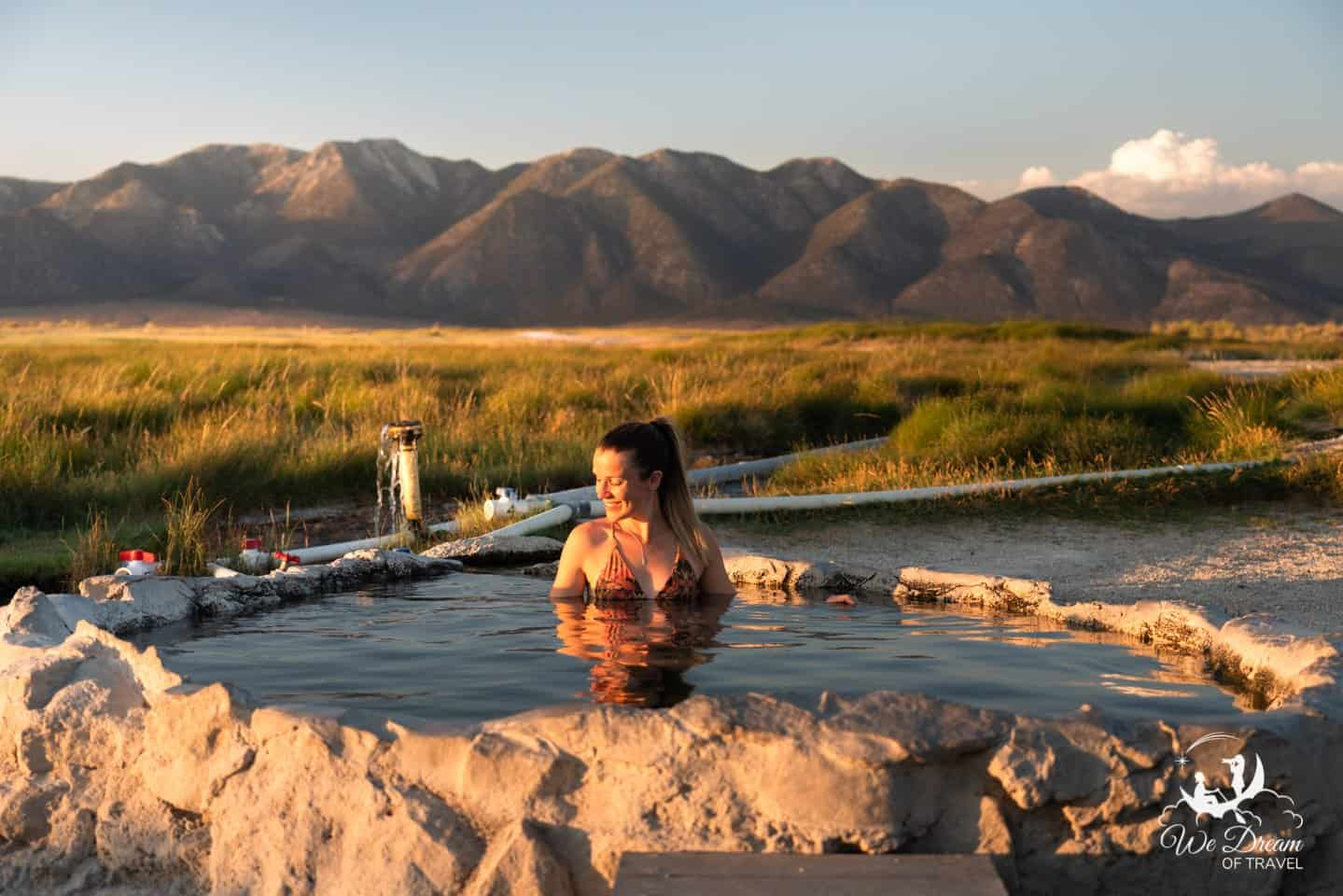 Golden light floods in during a sunset soak at Pulkey's Pool, one of six hot springs in Mammoth Lakes.