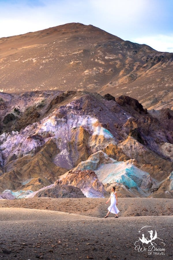 Sophie strolls beside Artists Palette in the setting sun of Death Valley.