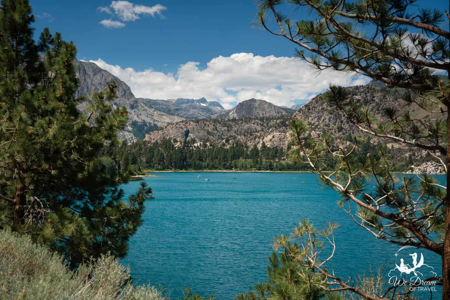 Gazing out at the inviting waters of June Lakes from a roadside viewpoint.