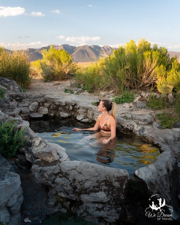 A visitor of Rock Tub hot springs in Mammoth Lakes has an evening soak.