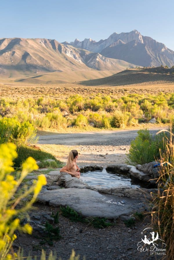 A beautiful girls enjoying golden light during a sunset soak in Rock Tub Hot Springs.