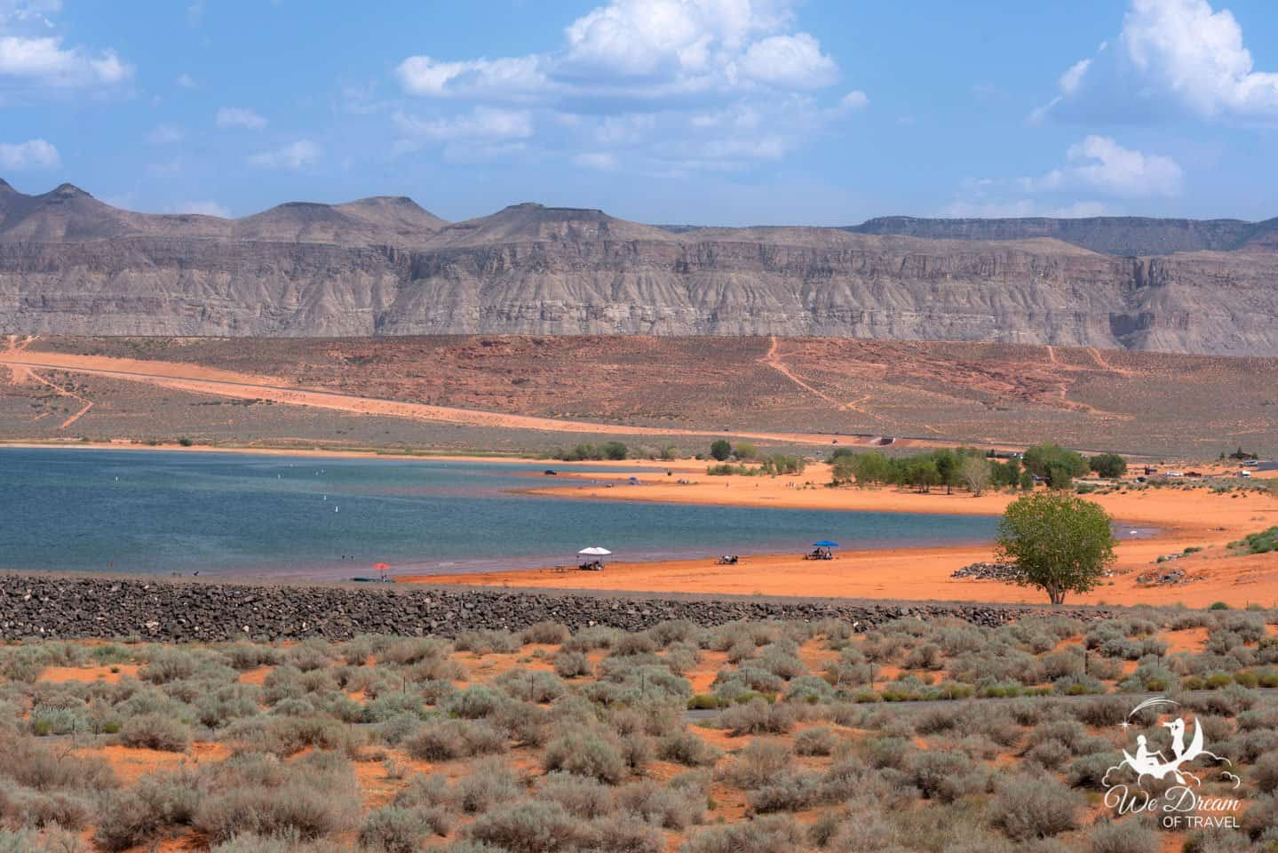 The orange sand beach at Sand Hollow State Park is a great place for families to spend the day near St George, Utah.