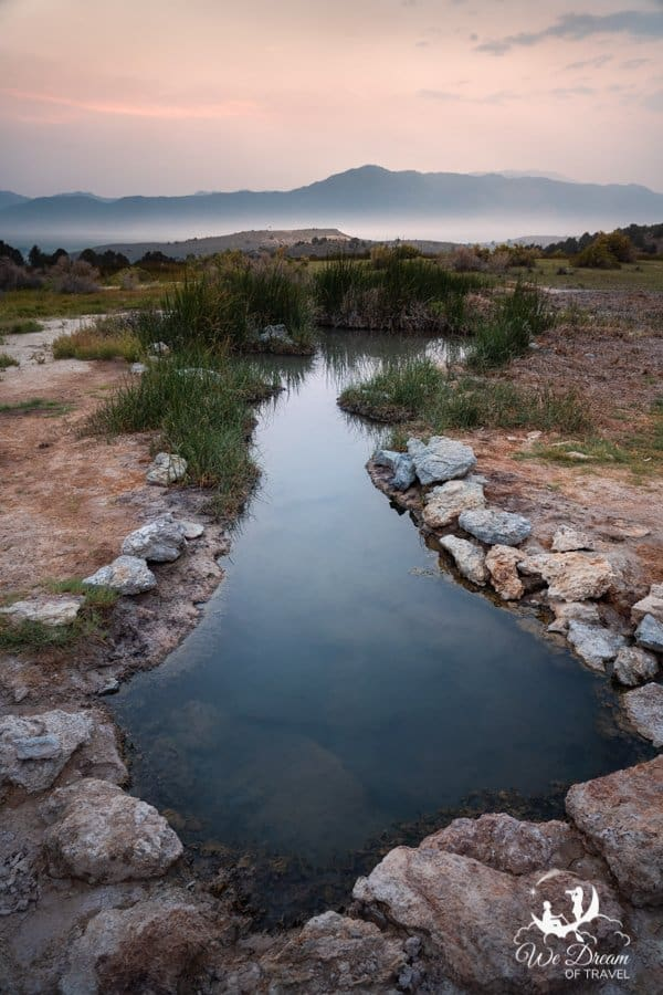 An empty secret hot spring at Travertine during sunset.