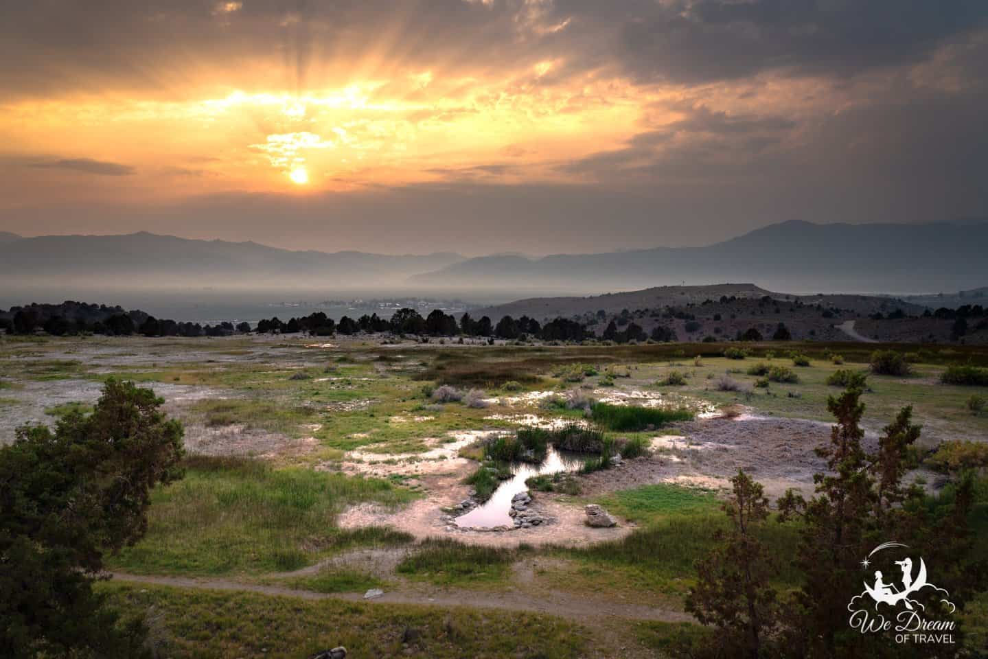 Sunset over the mountains behind one of the secret hot springs at Travertine.