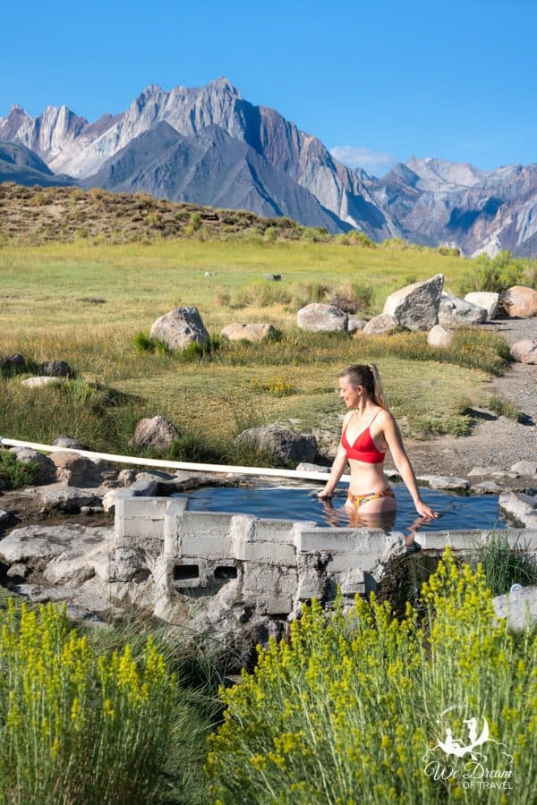 A young girl enjoys the stunning scenery of Mammoth Lakes in this photo of Shepherd Hot Springs.