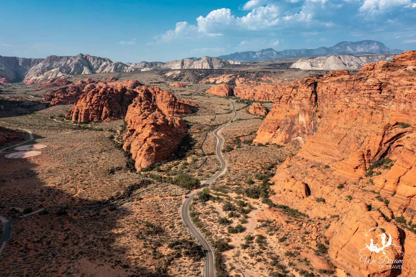 Aerial view of Snow Canyon State Park showing the road leading through the red rock landscape