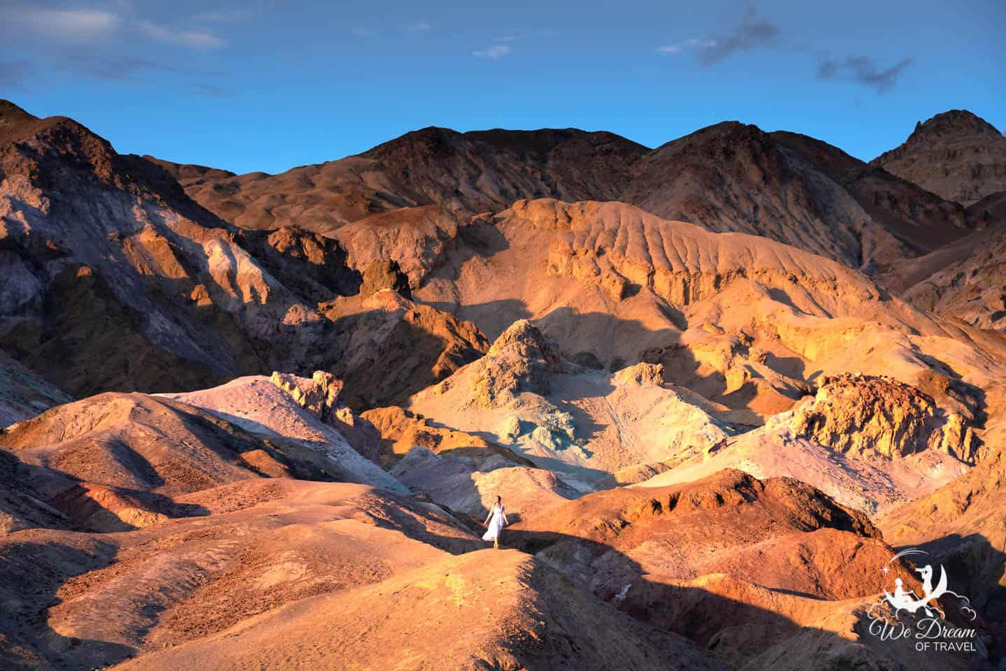 Walking the short trail to a picturesque perch at Artist Palette Overlook in Death Valley NP.