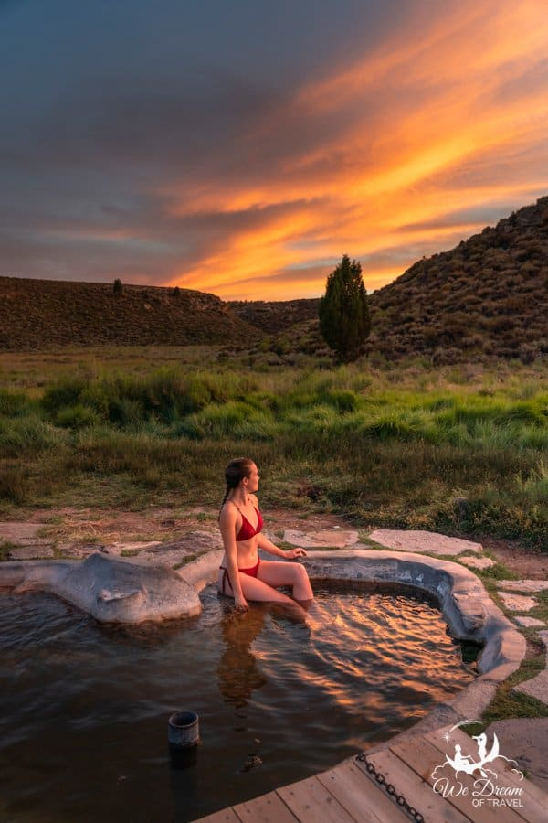 A moment of bliss during a skyfire sunset at the Siphon Tub hot spring in Little Hot Creek outside of Mammoth Lakes, CA.