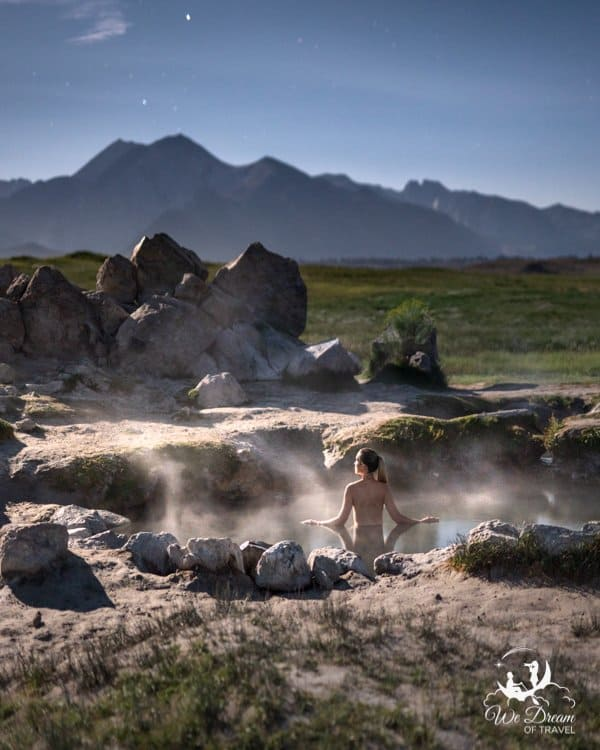 Soaking in Wild Willys Hot Spring also known as Crowleys Hot Spring in Mammoth Lakes under moonlight.