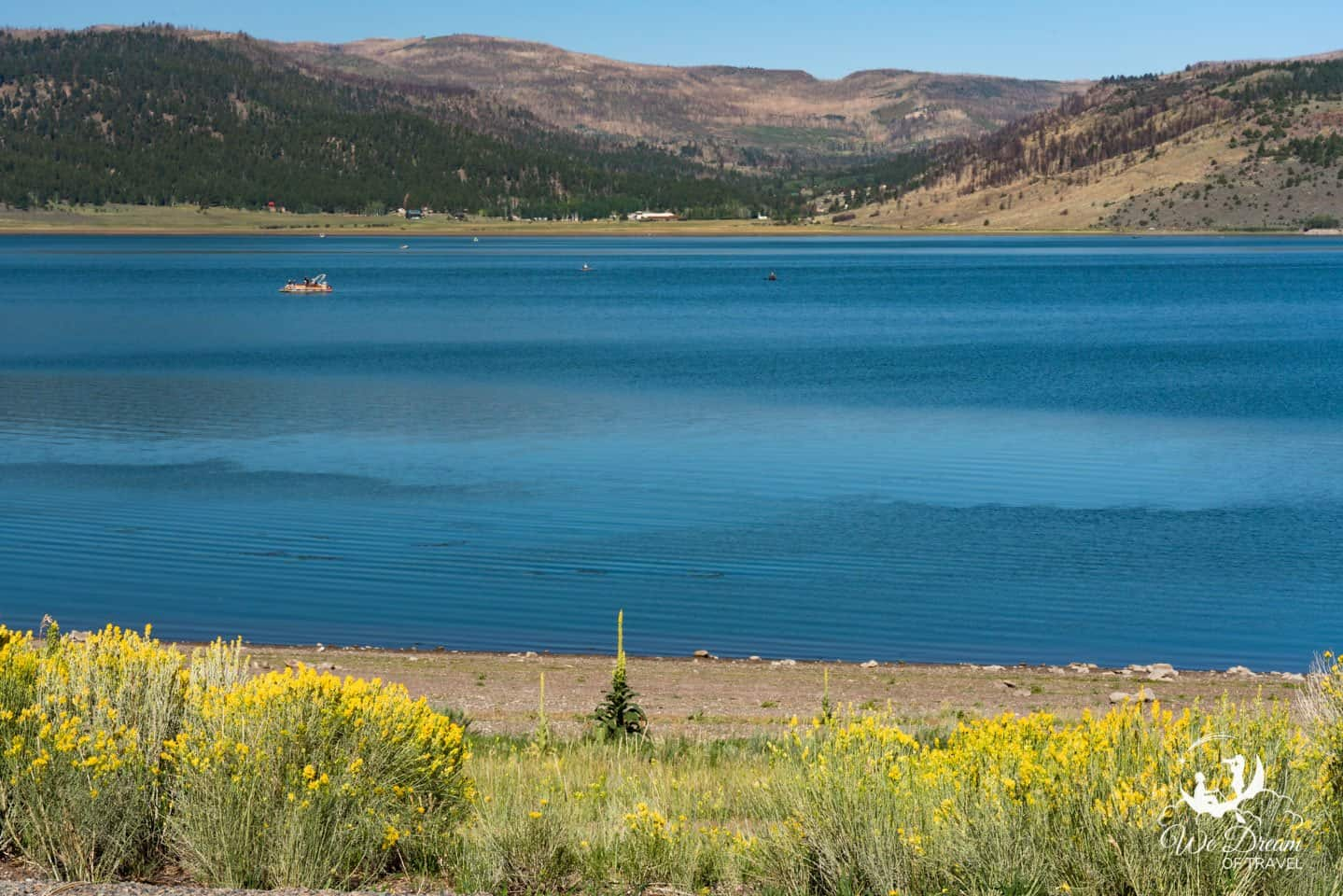 Escape the oranges and red with vibrant blues at Panguitch Lake in Dixie National Forest.